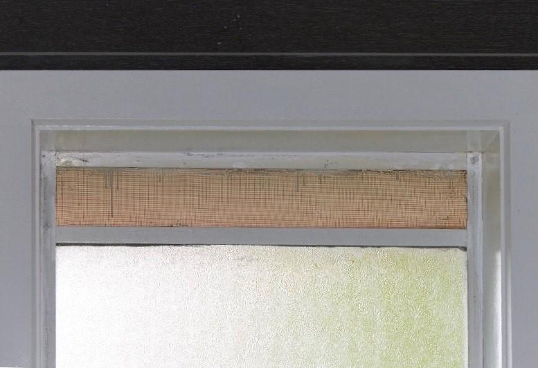 Bathroom window with gap above